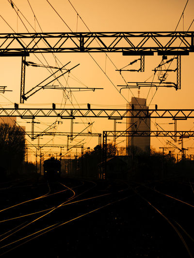 Silhouette of train station with the business building in the background