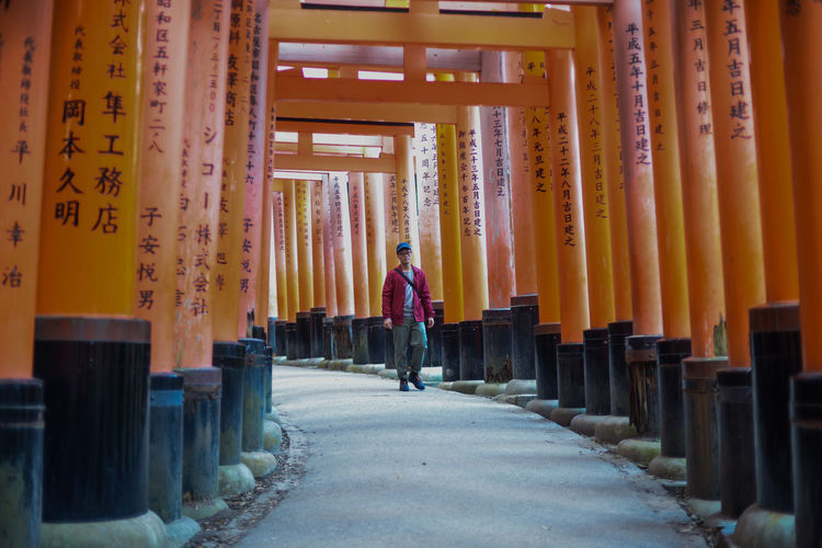 Man walking on walkway at temple