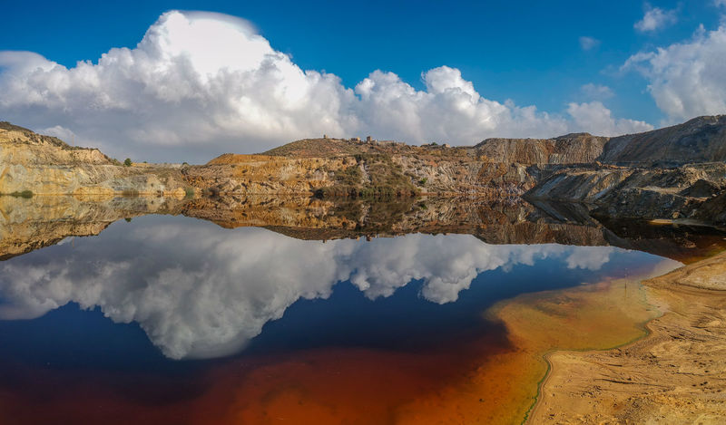 Polluted Water Beauty In Nature Cloud - Sky Day Landscape Mining Factory Mountain Nature No People Outdoors Reflection Scenics Sky Tranquil Scene Tranquility Water