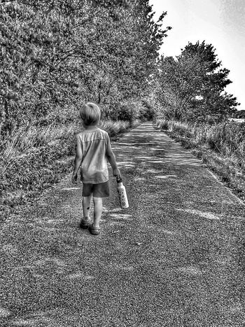 Boy walking on path Black And White Black & White Children Photography EyeEm Best Shots - Black + White Black&white Blackandwhite Blackandwhite Photography Kid Boy Children Childhood Memories Kids Playing Kids Having Fun Kids Being Kids People Childhood Nature Path Outdoors Out For A Walk Path Walking Walk Walking Alone... Memories Black And White Photography