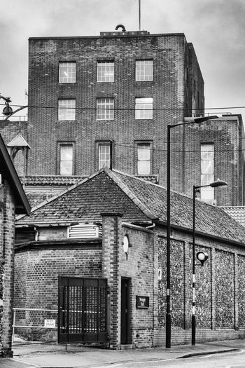 The brewery building in Bury St Edmunds, Suffolk, built in 1938, but there has been a brewery on this site for over 200 years. Brewery Horses Brewery Building Architecture Built Structure Building Exterior Building Black And White Black And White Photography Architecture Commercial Building Brickwork  Gated Entrance TOWNSCAPE Entrance Brick Black And White Architecture