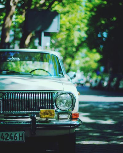 Old vintage car on street in city