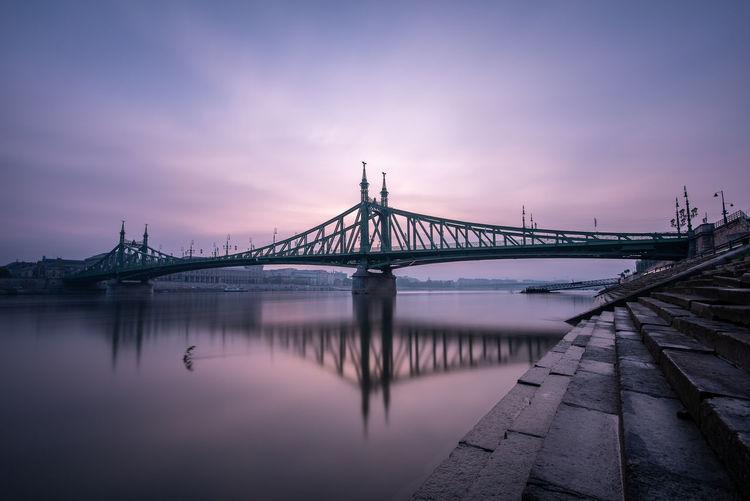 Bridge over river at sunsunrise