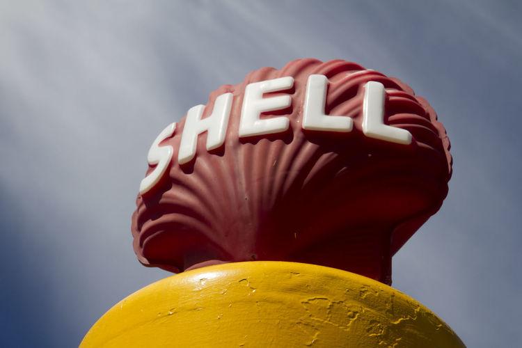 Historic Petrol Pump Shell Branding Shell Petroleum Signage Shell Text Close-up Communication Historic Petrol Low Angle View No People Shell Petroleum Sky