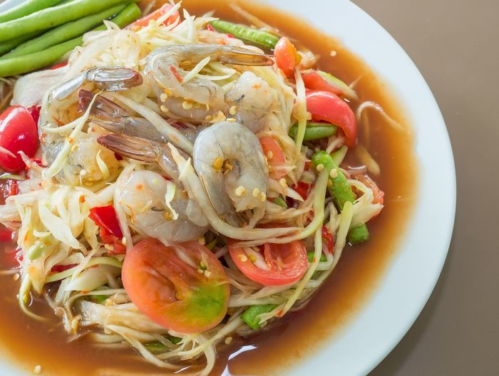 "Thai green papaya salad, which in Thailand is known as ""Som Tam"" Hot Thai Food Hit Thai Food Thailand Food Culture Papaya Thai Food Som Tam Ready-to-eat Food And Drink Freshness Food Plate Serving Size Still Life Healthy Eating Close-up"