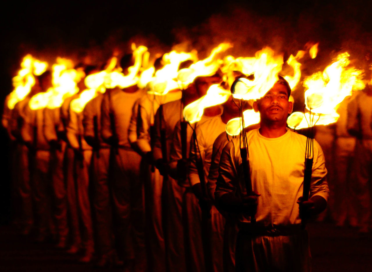 People With Fire Performing Dance At Night