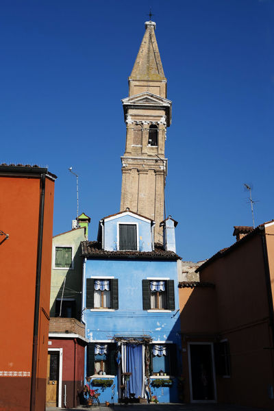 Architecture Architecture Bell Bella Italia Belltower Blue Building Exterior Built Structure Burano Burano, Italy City Clear Sky Clock Clock Face Clock Tower Day Fisherman Island Laguna No People Outdoors Painted Houses Sky Travel Destinations Venice, Italy