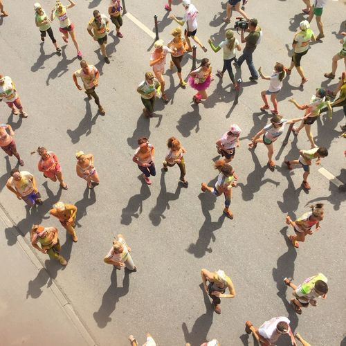 High Angle View Of People Running In Marathon On Road