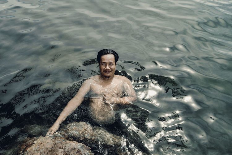 High angle portrait of man swimming in lake