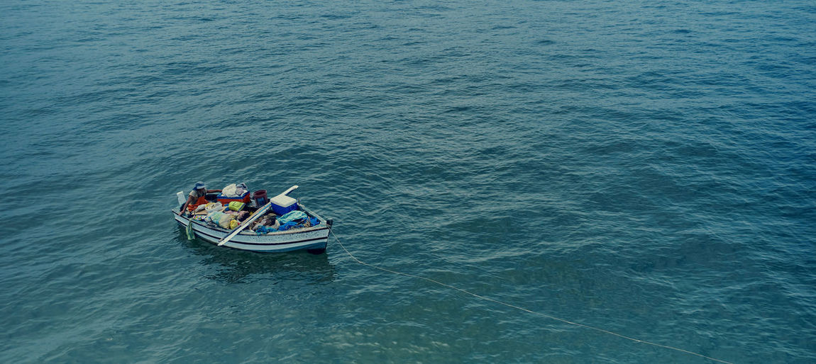 High angle view of people in boat sailing on sea