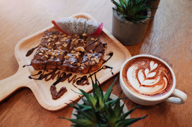 Hot Coffee on wooden table with chocolat on bread Food And Drink Table Coffee - Drink Food Coffee Drink Still Life Refreshment Freshness Hot Drink Indoors  Coffee Cup Latte Plant Cup Wood - Material Mug No People Cappuccino Leaf Frothy Drink Temptation Crockery