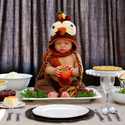 Boy dressed as turkey on plate