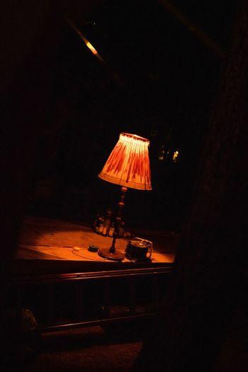 Illuminated electric lamp at night