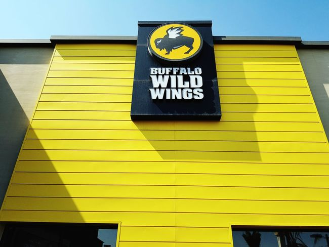 Yellow at Buffalo Wild Wings in Riyadh City Yellow Text Outdoors Architecture No People City Blue Food And Drink Saudi Arabia Paint The Town Yellow