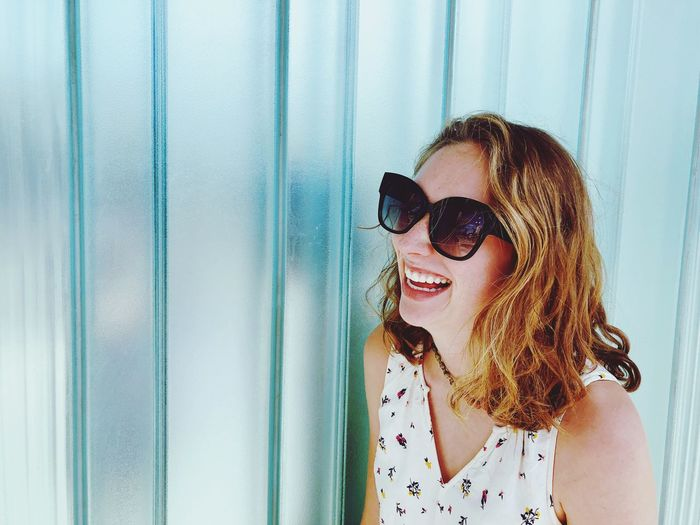 Laughing woman with glasses Sunglasses Glasses Portrait Headshot One Person Lifestyles Fashion Leisure Activity Women Happiness Emotion Beauty Beautiful Woman Young Adult Real People Smiling Hairstyle Young Women Hair Adult