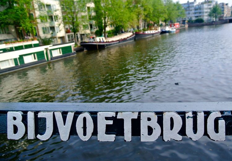 B Bijvoetbrug Amsterdam Amsterdam Canal Amsterdam, Netherlands B Bijvoetbrug Bijvoetbrug Boats Built Structure Canal Canals Canals And Waterways Capital Letter EyeEm Best Shots Mode Of Transport Nautical Vessel Netherlands Railing River Showcase April Sign Staalstraat Transportation Water Waterfront Your Amsterdam Zwanenburgwal Your Ticket To Europe