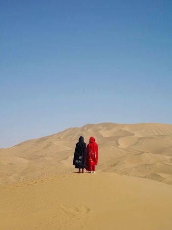 DesertGuards Sand Desert Sand Dune Arid Climate Landscape Clear Sky Extreme Terrain Copy Space Nature Togetherness Remote Scenics Day Outdoors Real People Tranquil Scene Sunlight Full Length Lifestyles Sky Lost In The Landscape