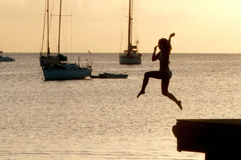 One Person Sea Silhouette Water Outdoors Sunset Horizon Over Water Motion Sky Beach Being A Beach Bum Tourist Attraction  Travel Destinations Puerto Rico Caribbean Life Taking Photos Taking Pictures Having A Good Time Games Adventure Boqueron Dive In Jump No Fear Family