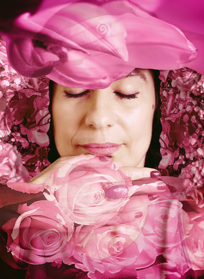 Close-up of woman with pink roses