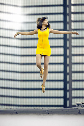 floating Afroeuropean Afroeuropean Beauty Afroeuropean Girl Dreaming Fashion Lifestyle Floating Floating Girl Flying Flying High Hover Hoverfly Jumping ! Wall - Building Feature Yellow Yellow Dress