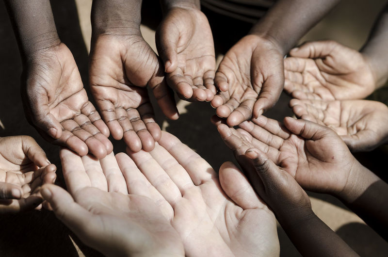 Cropped image of people showing hands
