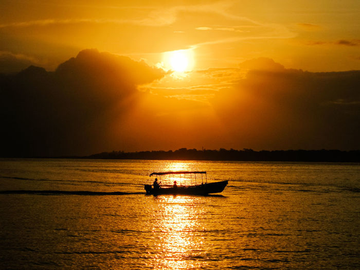 Single Boat on Water during sunset in South East Asia ASIA Orange Sky Orange Sunset South East Asia Travel Travel Photography Boat On Water Golden Hour Malaysia No People Outdoors Romantiv Single Boat Sundown Sunset Travel Destinations