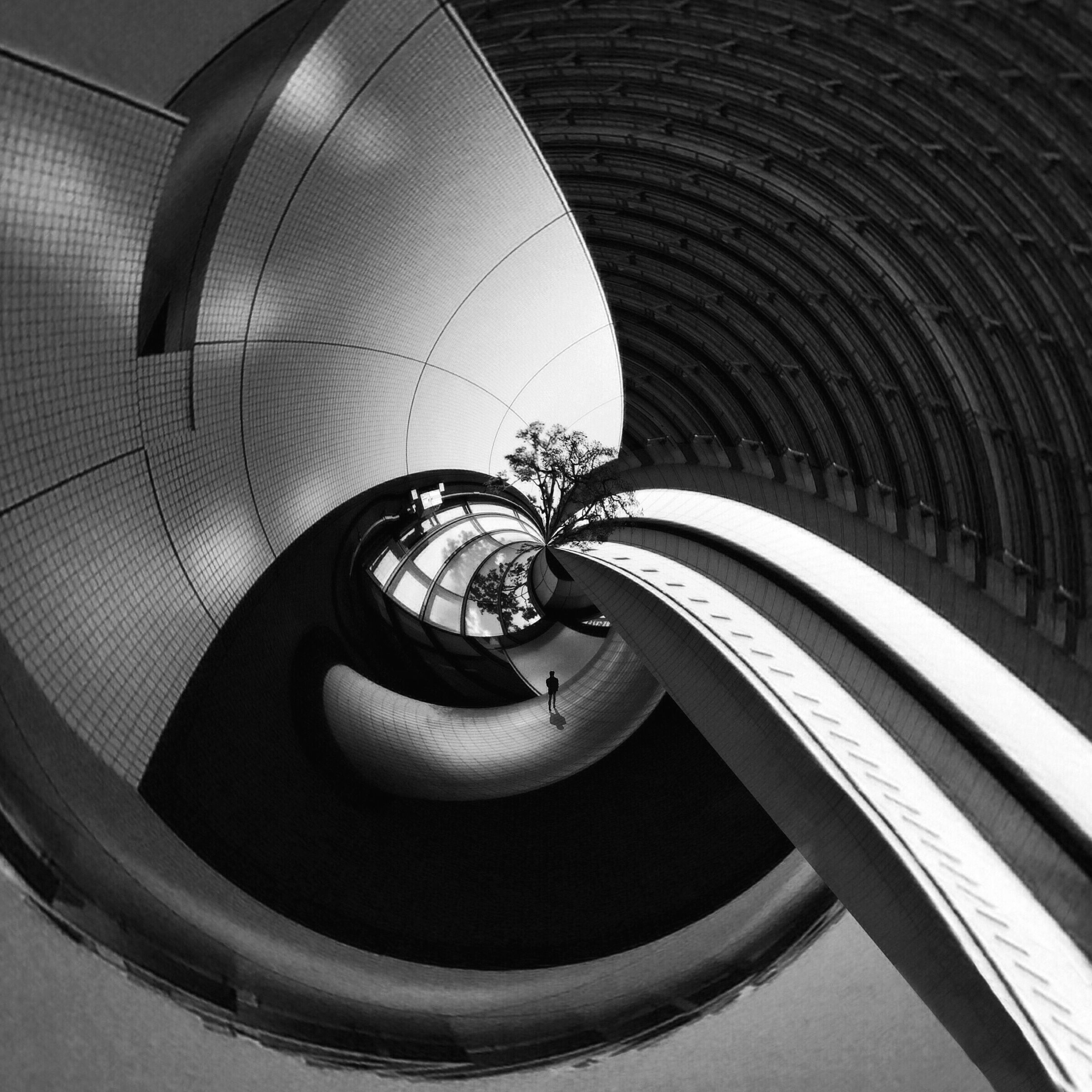 built structure, architecture, indoors, spiral, circle, spiral staircase, ceiling, modern, directly below, low angle view, pattern, staircase, railing, steps and staircases, architectural feature, steps, curve, building, geometric shape, design