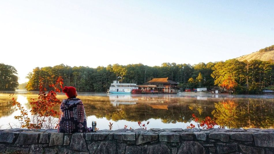 Rear View Water Nature Lake Tree Autumn Real People Clear Sky Outdoors Full Length Beauty In Nature Lifestyles Women Tranquility Sitting Forest One Person Landscape Rural Scene Hat Red Hat
