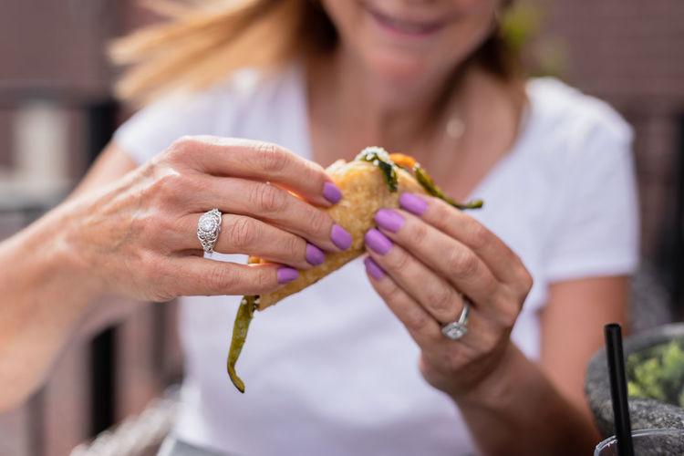 Close-up of woman holding ice cream