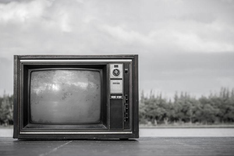 Abandoned Television Set Against Sky