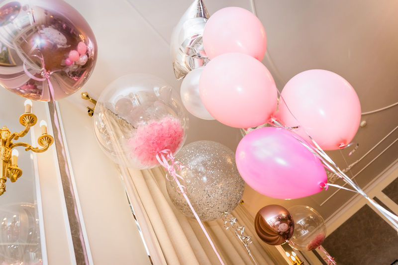 Low angle view of balloons on table