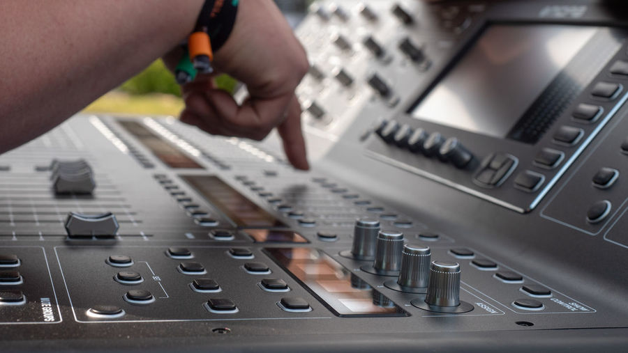 Cropped hand using sound mixer