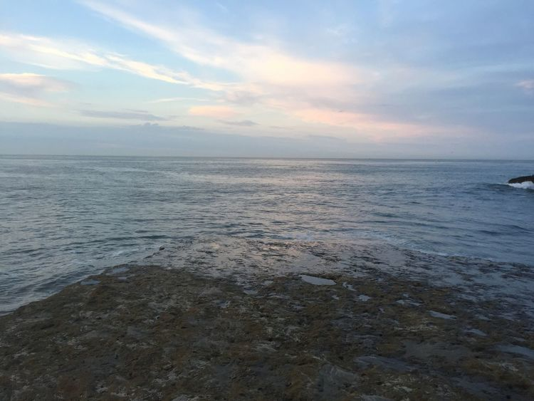 Beach Coastline Distant Dramatic Sky Exploring Horizon Over Water Outdoors Rock Formation Sea Shore Summer Surf Tidal Rock Formations Tranquil Scene Vacation Vacations