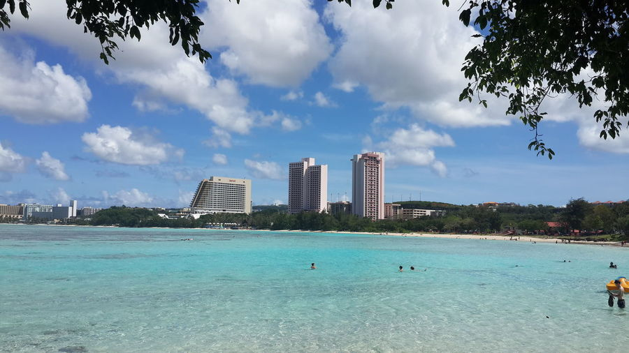 Guam EyeEm Selects EyeEmNewHere Summer In The City Guamsunset Guam Island Guam Life City Tree Water Urban Skyline Beach Skyscraper Sea Modern Cityscape Sand