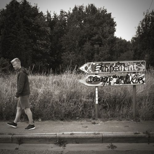 He's on the road to nowhere...no city on his mind. Bnw_friday_signs Bnw_mark Tree Outdoors Full Length One Person Day Real People Nature Sky Bnw Bnw_collection Graffiti Blackandwhite Young Adult 1:1 Doel België Doel Belgium Road Your Ticket To Europe EyeEmNewHere The Week On EyeEm Connected By Travel