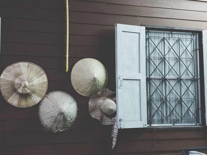 we have a lot of hat in my house Blackground Hats Urban Thailand Culture Culture Traditional Pastel Wood Wall Wood Wall Wood Window Brown Brown Wall Electric Pipes Yellow Pipe Electric Fan Hanging