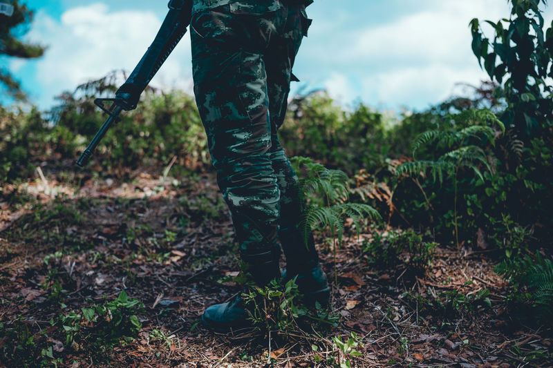 Day Field Focus On Foreground Forest Green Color Growth Human Leg Land Leisure Activity Lifestyles Low Section Nature One Person Outdoors Plant Real People Rear View Standing Tree