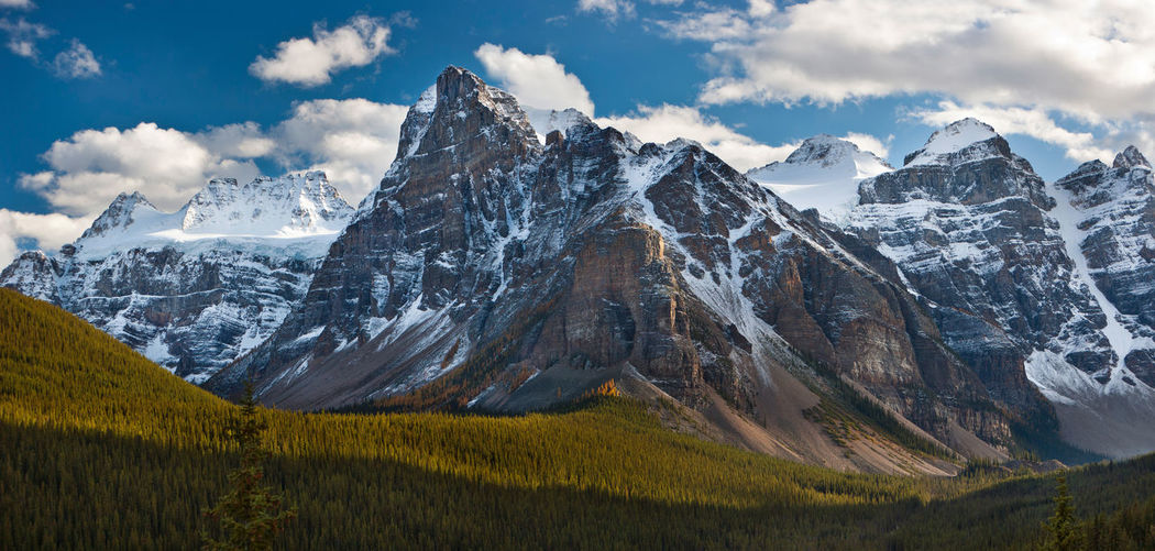 Mountain range near Banff, Canada. Banff National Park  Beauty In Nature Canada Cloud - Sky Cold Temperature Environment Landscape Mountain Mountain Peak Mountain Range Nature No People Non-urban Scene Outdoors Scenics - Nature Sky Snow Snowcapped Mountain Tranquil Scene Tranquility Winter
