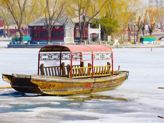 Boat On Frozen Lake