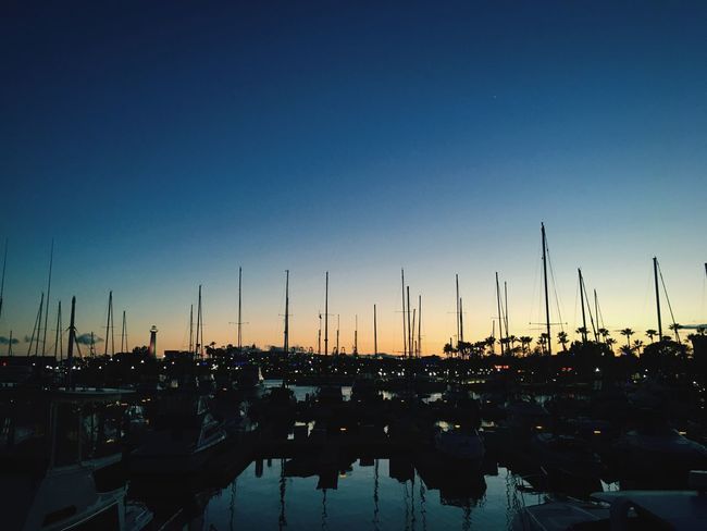 Sky No People Clear Sky Silhouette Nautical Vessel Water Sunset Nature Blue Sailboat Dusk Copy Space Pole Lighting Equipment Mode Of Transportation Scenics - Nature Marina