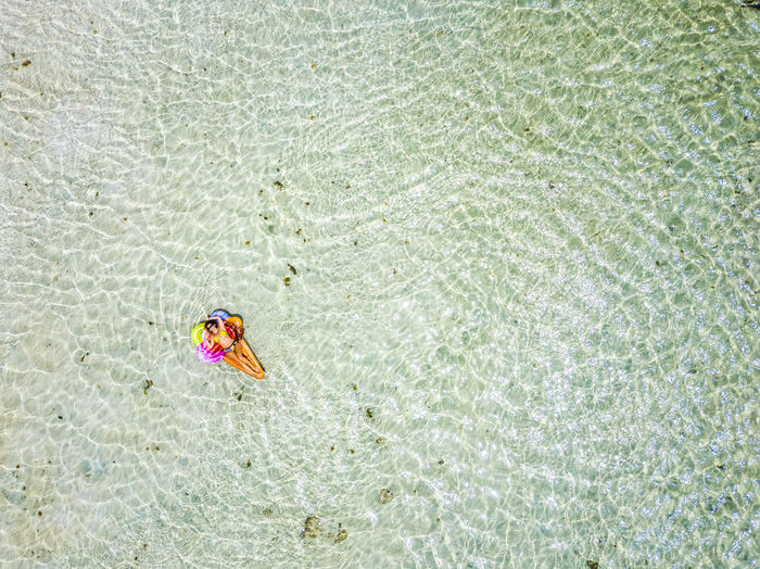 Aerial view of woman swimming in sea