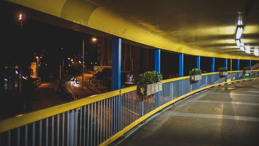 Elevated Walkway Over Street At Night