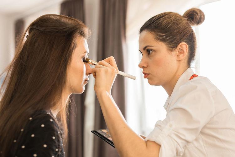 Make-up artist applying make-up
