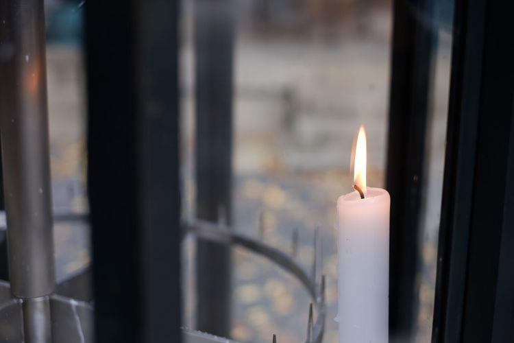 Close-up of burning candle