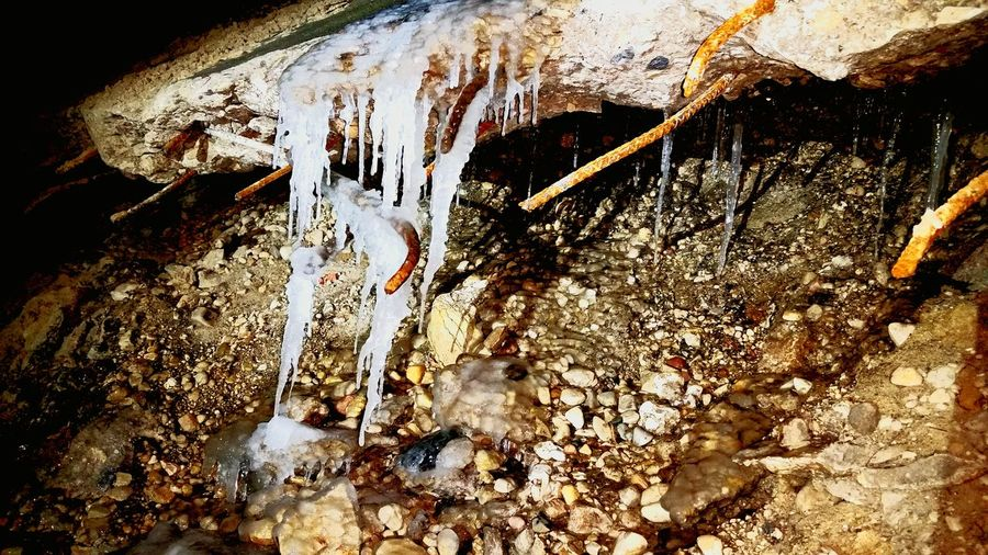 Outdoors Close-up Night Rubble Rebar Ice Destruction Cement Winter Drainage Channel Icicles Contrast Shadow River Rocks