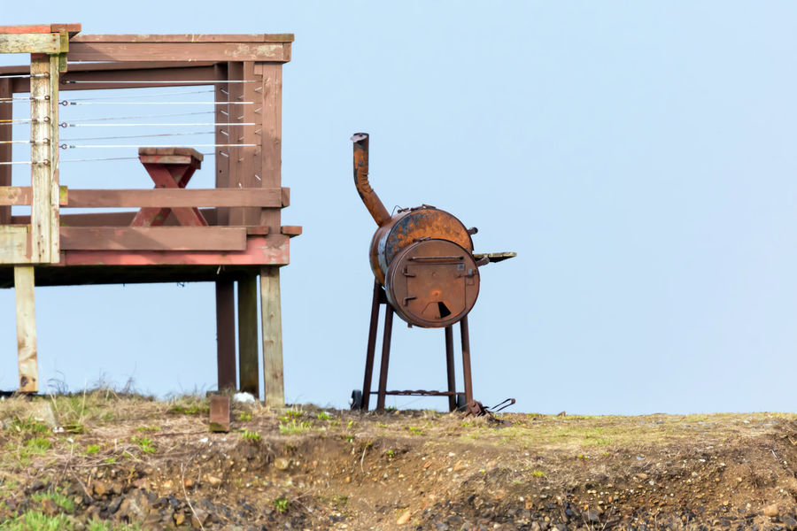Barque Blue Blue Sky By The Sea Cooking Day In The Distance Lonely Man Made Object ManmadeVsNature No People Not Used Anymore Object Photography Objects Of Interest Odd Old Things Outdoors Pipe - Tube Round Rust Rusty Rusty Metal Rusty Things Sky Smoker