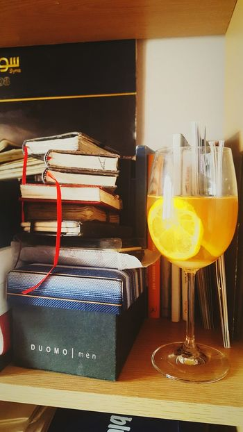 Drink Alcohol Cocktail Indoors  Refreshment Close-up Light And Shadow Simplicity Tea Camomile Tea Lemon Tea Camomile And Lemon Tea Wine Glass Books Notebooks  Asthetic Vintage Wine Glass On Shelf Artistic Food Stories Love Yourself