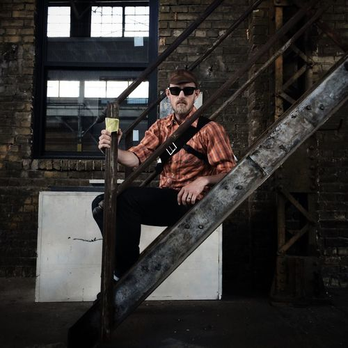 Portrait of a mid adult man sitting on stairs