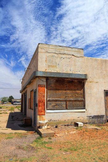 Abandoned building and blue sky Abandoned Places West Texas Skies Lamesa TX Rust Toilet Bowl Architecture Built Structure Building Exterior Building Cloud - Sky Sky Nature Day No People Door Weathered Closed Old Sunlight