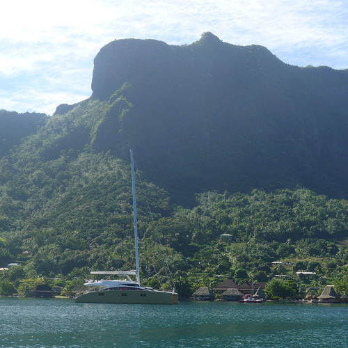 Beauty In Nature Day Moorea Mountain Mountain Range Nature Nautical Vessel No People Outdoors River Sailing Scenics Sky Tranquil Scene Tranquility Transportation Tree Water Waterfront